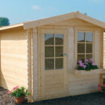 Cómo instalar una cabaña de madera en el jardín